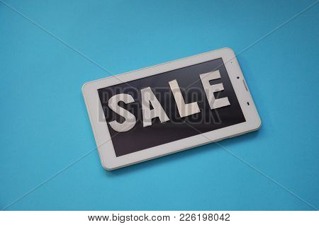 Holiday Sale Concept. View From Above. Flat Lay. Online Shopping. Digital Tablet, Computer