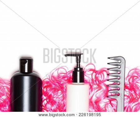 Curly Hair Care And Styling Concept. Cosmetic Products With Wide Tooth Comb And Bright Pink Doll Hai