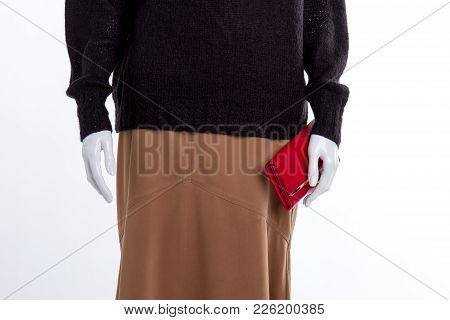 Close Up Black Sweater And Brown Skirt. Female Mannequin With Skirt, Pullover And Wallet Close Up.