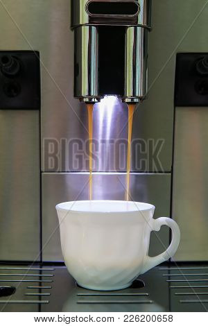 Coffee Machine Pours Hot Coffee In Cup
