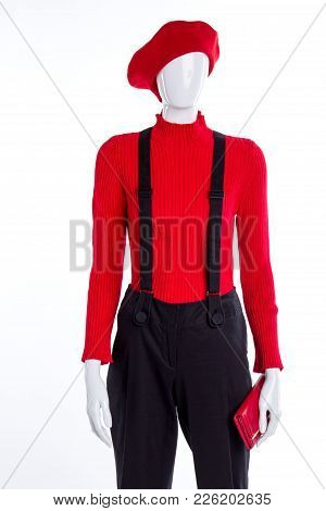 Red Beret, Sweater And Wallet. Female Mannequin Dressed In Trousers With Suspenders. Fashion Is Our