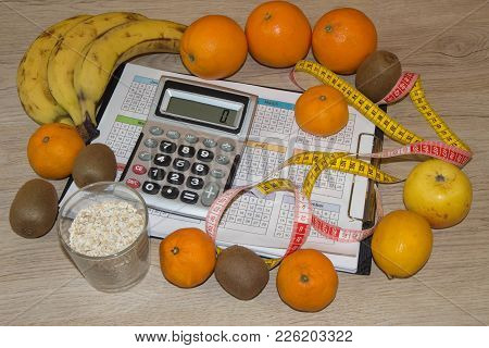 Scale With Healthy Heart Message And Measuring Tape On Table. Weight Control Concept. Fruit Diet. Lo
