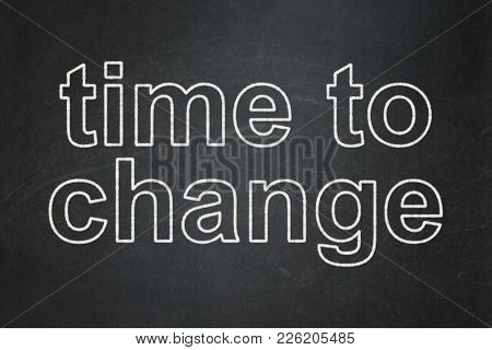 Time Concept: Text Time To Change On Black Chalkboard Background