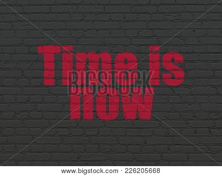Time Concept: Painted Red Text Time Is Now On Black Brick Wall Background