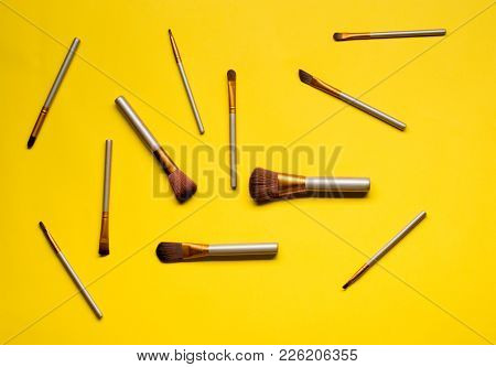 Makeup Brush Set On Colourful Background. Flat Lay.
