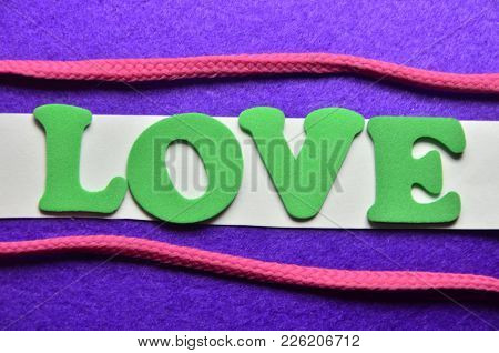 Word Love On An  Abstract Colo0red Background