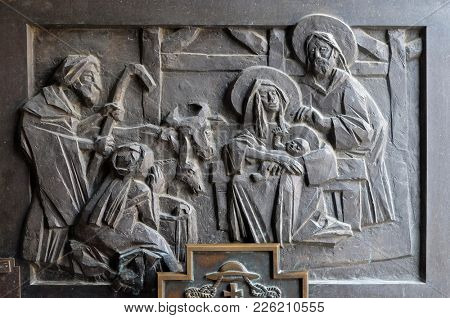 VARAZDIN, CROATIA - JULY 09: Birth of Jesus, detail of the entrance door of cathedral of Assumption in Varazdin, Croatia on July 09, 2016.