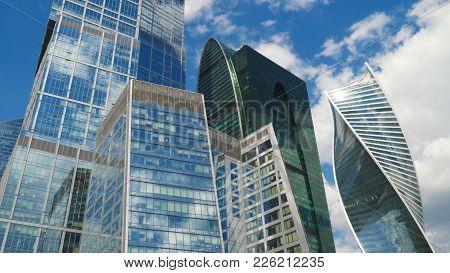 Reflection Of Clouds In Skyscraper Windows. Reflection Of Clouds In Skyscraper Windows