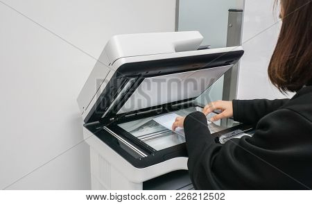 Close Up Businesswoman In Black Jacket Put Documents On Printer For Scanning And In Office