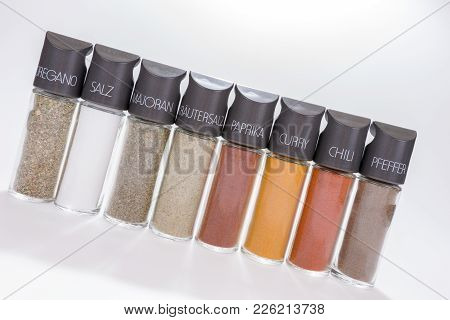 Row Of Eight Spices And Spice Mixes, Brand-name Spices In German Language