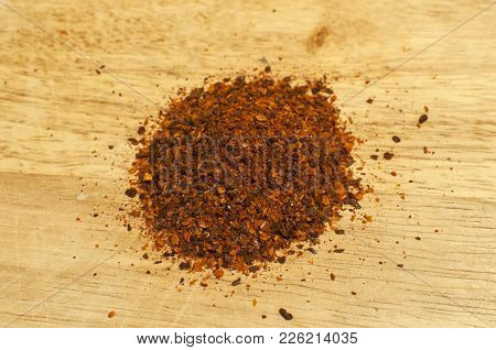 A Pile Of Dried Crushed Coarse Ground Red Hot Pepper Chilli Flakes And Seeds Spice Powder Closeup On