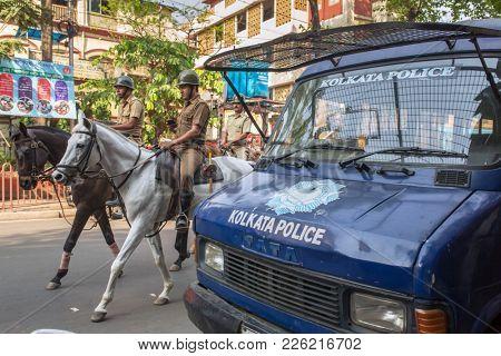 Kolkata, India - April 3, 2017: Horse mounted police patrolling streets in Kolkata downtown, West Bengal, India.