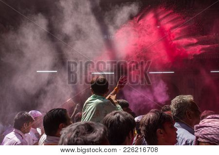 Vrindavan, India - March 19, 2016: Unidentified man sell colorful powdered dyes used for Holi festival in India Holi celebration in the Hindu Banke Bihare temple in Vrindavan, Uttar Pradesh, India.