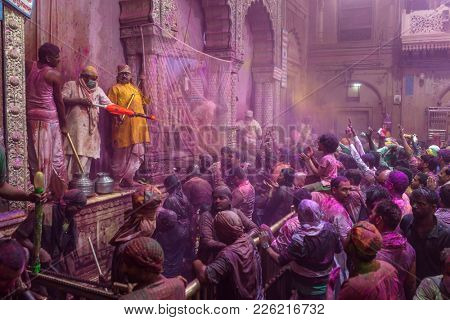Vrindavan, India - March 20, 2016: Holi celebration in the Hindu Banke Bihare temple in Vrindavan, Uttar Pradesh, India.