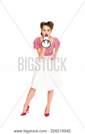 Fashionable Young Woman In Pin Up Style Clothing Screaming Into Loudspeaker Isolated On White