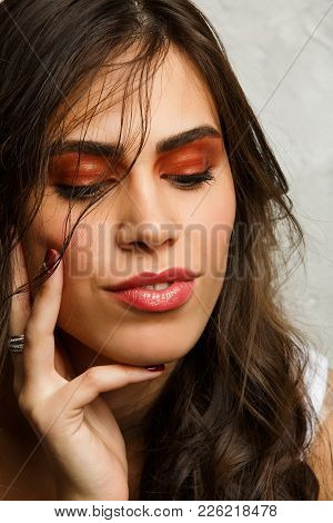 Image Of Satisfied Brunette With Closed Eyes And Bright Make-up On Gray Background