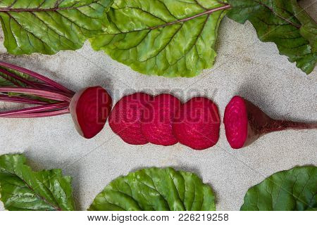 Raw Beetroot Sliced With Leaves On Rustic Board . Top View, Copy Space.
