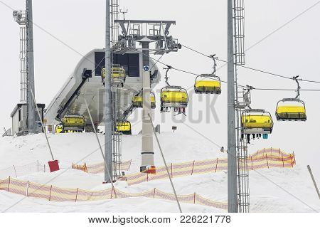 Ski Lift On A Mountain For Skiers And Snowboarders On A Background Of White Snow. Winter Sports, Act