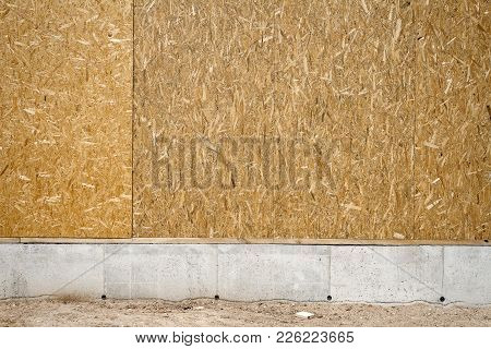 Empty Chipboard Fence With A Copy Space On A Concrete Basement