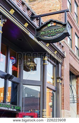 Nebraska, Usa - Aug 8, 2017: Frontage Of Mcfarland & Sons Authentic Irish Pub At The Haymarket Distr