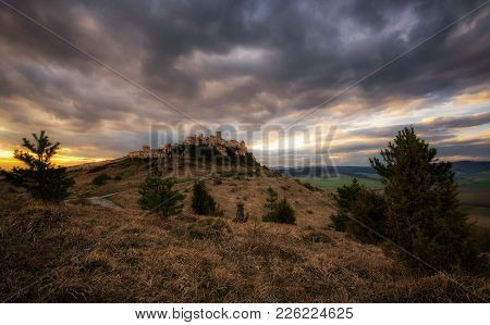 Dramatic Sunset Over The Ruins Of Spis Castle In Slovakia.  Spis Castle Is A National Monument And O