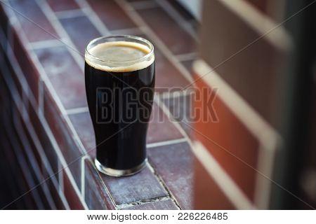 Pint Of Stout On Bricks