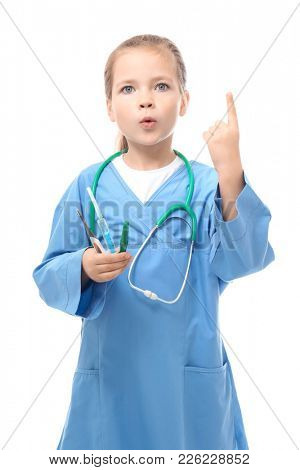 Cute little girl in doctor uniform  on white background
