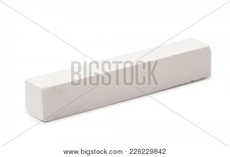 Piece of white chalk isolated on white