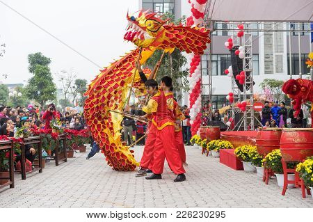 Hanoi, Vietnam - Feb 7, 2015: A Show Of Lion And Dragon Dance At Vietnamese Lunar New Year Festival