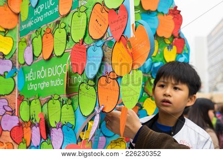 Hanoi, Vietnam - Feb 7, 2015: Children's Promises Writen On Papers Hanging On Tree At Vietnamese Lun