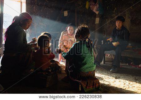 Ha Giang, Vietnam - Feb 13, 2016: H'mong Ethnic Minority Family Having Lunch In Their House In Yen M