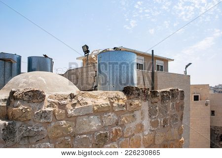 Horizontal picture of metal drum was fired with a firing gun in front of a Jewish settlement in Hebr