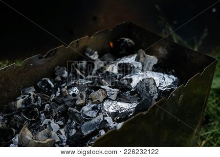 Potatoes In Foil Are Cooked In Coals