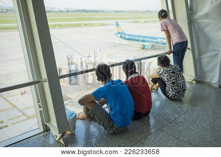 Hanoi, Vietnam - July 12, 2015: Asian Customers Look At Airplane While Waiting For Boarding Time At