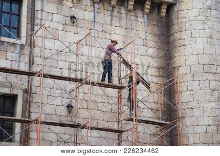 Da Nang, Vietnam - Apr 2, 2016: Workers With No Protection Belt Fixed On Scaffold At Construction Si