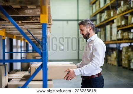 Handsome Male Warehouse Worker Or A Supervisor.