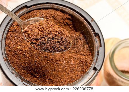Coffee, Ground In A Coffee Grinder, Be Filled Upinto A Jar With A Spoon