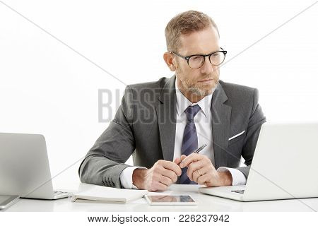 Businessman With Laptop At The Office
