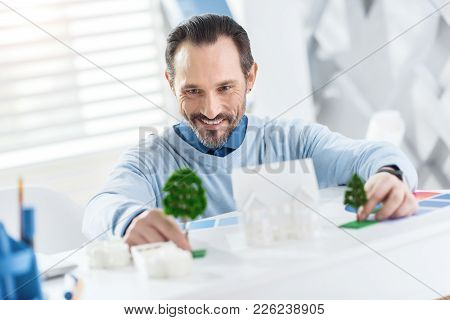 Making A Planning. Good-looking Exuberant Dark-haired Bearded Man Smiling And Making A Plan Of A Fut