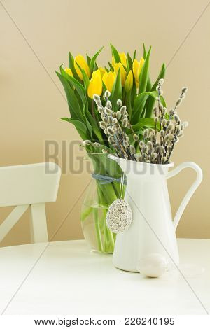 Fresh Willow Catkins In White Pot And Tulips Flowers With Easter Eggs