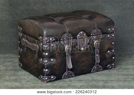Chest With Closed Lid On A Green Background