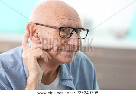 Hearing impaired man at home