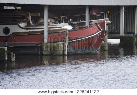 Leiden / The Netherlands - February 7 2018 - A Old Boat Laying Peacefull And Quiet On A Dock In A Ha