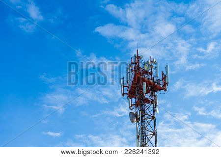The Communication Tower On Blue Sky Background.