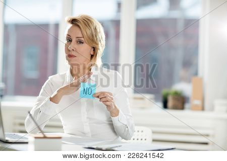 Businesswoman with negation sticker prohibiting to do something in office