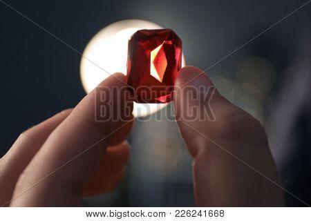 Jeweler holding gem, closeup