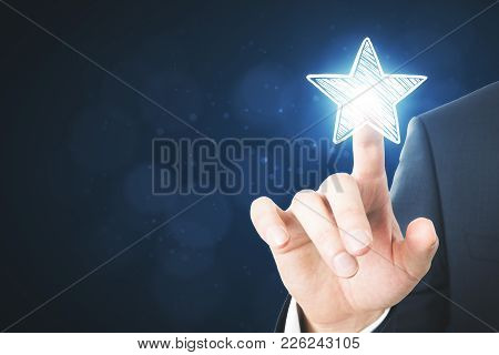 Businessman Pointing At Abstract Stars On Blurry Blue Background. Experience Rating And Advertisemen