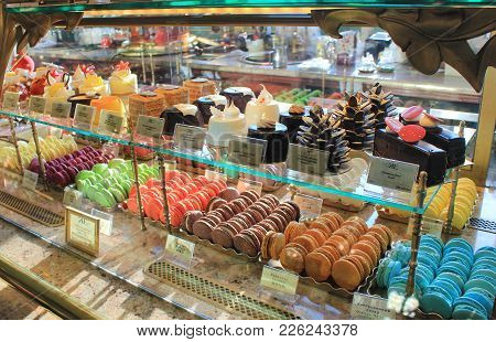St. Petersburg, Russia - February 8, 2018: Candy Store Showcase With Sweet Food. Macaroons And Cakes