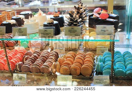 St. Petersburg, Russia - February 8, 2018: Candy Shop Showcase With Macaroons, Cheesecake, Pie, Cake