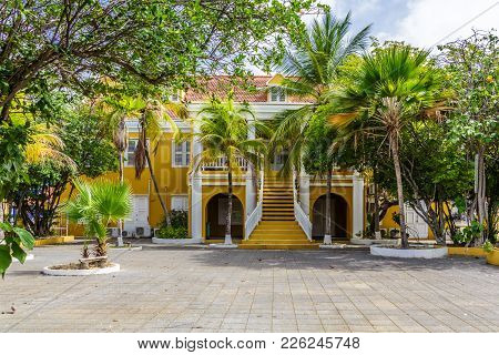 Bright Yellow Stucco Government Building On Bonaire
